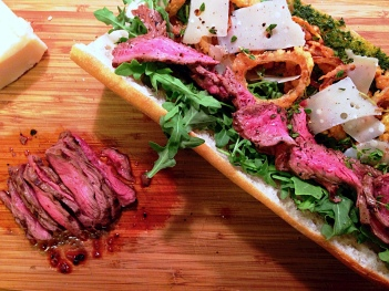 Steak, Fried Onions and Arugula Sandwich